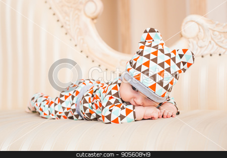 Portrait of a crawling baby on the bed in her room stock photo, Portrait of a crawling baby on the bed in her room by Satura86