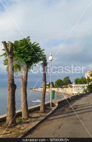 Trees along the pavement stock photo, Trees along the pavement. Old Town Nesebar, Bulgaria. Sunny summer day. Bulgarian Black Sea Coast. Vertical shot. by Veresovich