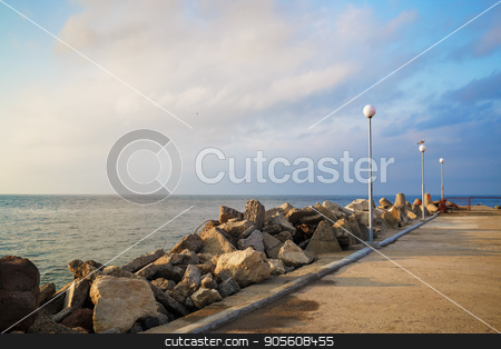 Breakwater with lampposts stock photo, Breakwater with lampposts. Pierce with boulders on the Black Sea coast. Summer day. by Veresovich