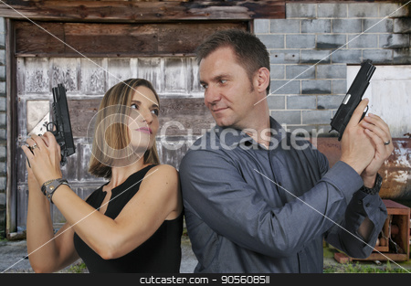 Man and woman spies stock photo, Man and woman secret agent spies with guns by Robert Byron
