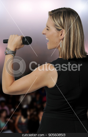 Woman Singer stock photo, Beautiful woman singer performing at a concert by Robert Byron