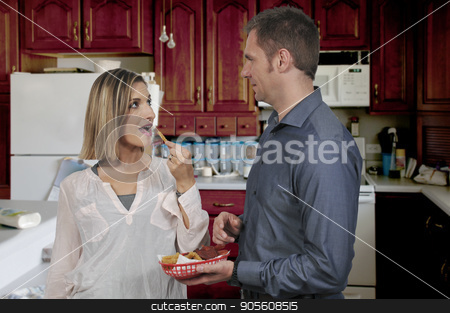 Stealing french fries stock photo, Wife or girlfriend stealing french fries from her boyfriend or husband by Robert Byron
