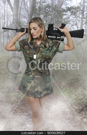 Young Woman Soldier stock photo, Beautiful young woman soldier with an assault rifle by Robert Byron
