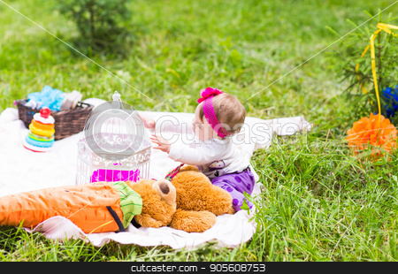 Cute little happy baby girl with big brown teddy bear on green grass meadow, spring or summer season stock photo, Cute little happy baby girl with big brown teddy bear on green grass meadow, spring or summer season by Satura86