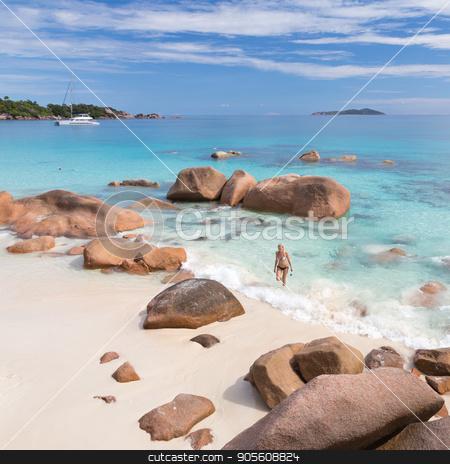 Woman enjoying Anse Lazio picture perfect beach on Praslin Island, Seychelles. stock photo, Woman wearing stylish bikini enjoying swimming and snorkeling at amazing Anse Lazio beach on Praslin Island, Seychelles. Summer vacations on picture perfect tropical beach concept. by kasto