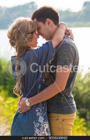 Portrait of happy girl hugging her boyfriend outside stock photo, Portrait of happy girl hugging her boyfriend outside by Satura86