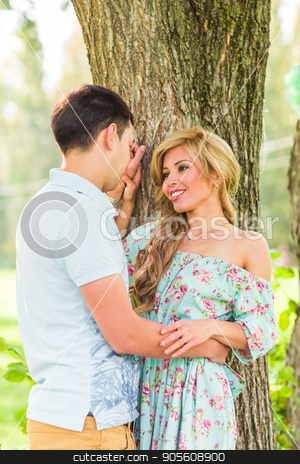 Young happy couple in the park. Man and woman in love stock photo, Young happy couple in the park. Man and woman in love by Satura86