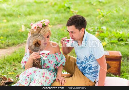 Happy Couple Having Romantic Picnic stock photo, Happy Couple Having Romantic Picnic in Countryside by Satura86