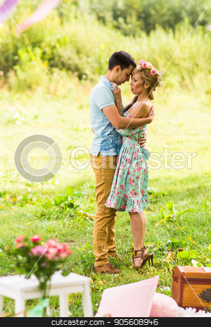 A couple in love beautiful young men hugging in a summer park on a sunny day stock photo, A couple in love beautiful young men hugging in a summer park on a sunny day by Satura86