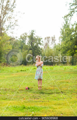 Portrait of the young beautiful romantic woman in dress outdoors stock photo, Portrait of the young beautiful smiling woman in dress outdoors by Satura86