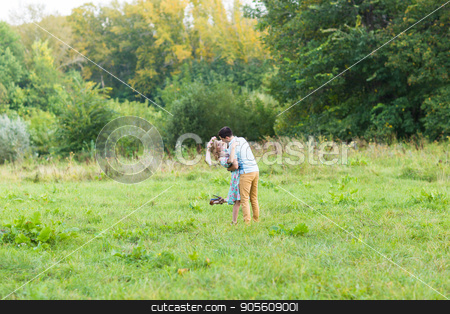 A couple in love beautiful young men and woman hugging in a summer park on a sunny day stock photo, A couple in love beautiful young men hugging in a summer park on a sunny day by Satura86