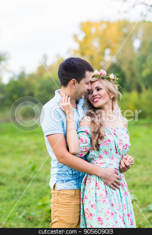 happy young couple hugging on nature stock photo, happy young couple kissing and hugging on nature by Satura86