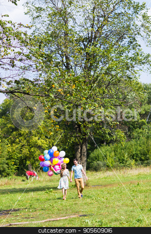 Young couple having weekend and walking with balloons on nature stock photo, Young couple having weekend and walking with balloons by Satura86