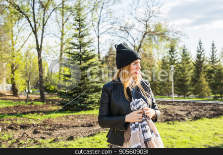 Stylish pregnancy concept. Portrait of happy pregnant woman in trendy clothing. Casual style stock photo, Stylish pregnancy concept. Portrait of happy pregnant woman in trendy clothing. Casual style by Satura86
