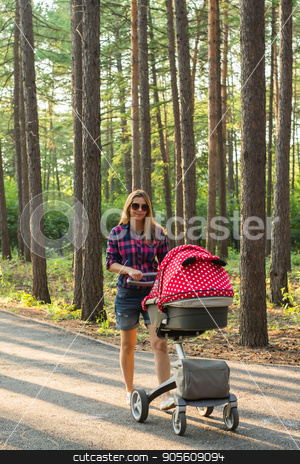 Young mother walking and pushing a stroller in the park. Woman strolling with newborn. Beautiful happy mom with pram outdoors. Summer walks in the sunny day. Girl with carriage stock photo, Young mother walking and pushing a stroller in the park. Mother strolling with newborn. Beautiful happy mother with pram outdoors. Summer walks in the sunny day. Girl with carriage by Satura86