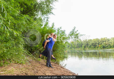 Young couple having fun at the beach of the lake on a sunny day stock photo, Young couple having fun at the beach on a sunny day by Satura86