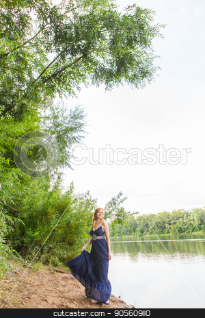 beautiful girl in dress on the river stock photo, beautiful girl in dress on the river outdoor by Satura86