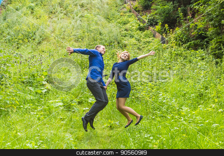 Fun couple in jump on the outdoor stock photo, Fun couple in jump on the outdoor background by Satura86