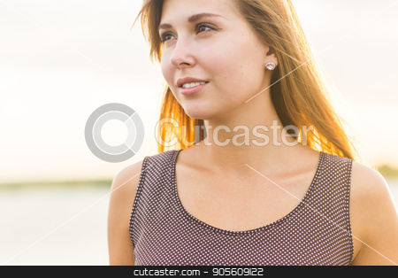 Close-up portrait of beautiful caucasian woman with charming smile walking outdoors stock photo, Close-up portrait of beautiful caucasian woman with charming smile walking outdoors by Satura86