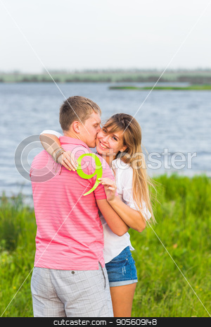 Man and woman holding the number 9 in nature. Concept of numbers, measurement, amount, quantity, accounting and mathematics stock photo, Man and woman holding the number 9 in nature. Concept of numbers, measurement, amount, quantity, accounting and mathematics by Satura86