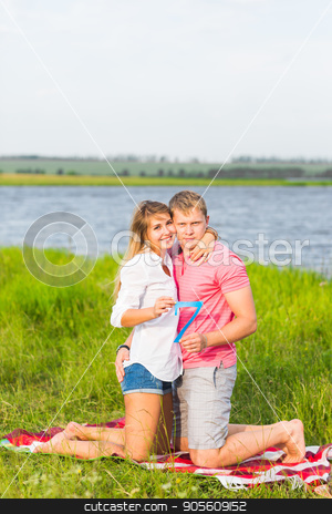 Man and woman holding the number 7 in nature. Concept of numbers, measurement, amount, quantity, accounting and mathematics stock photo, Man and woman holding the number 7 in nature. Concept of numbers, measurement, amount, quantity, accounting and mathematics by Satura86