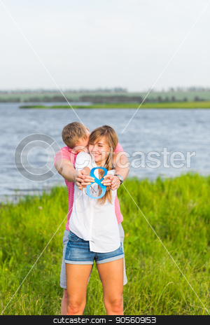 Man and woman holding the number 8 in nature. Concept of numbers, measurement, amount, quantity, accounting and mathematics stock photo, Man and woman holding the number 8 in nature. Concept of numbers, measurement, amount, quantity, accounting and mathematics by Satura86