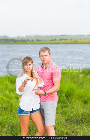 Man and woman holding the number 2 in nature. Concept of numbers, measurement, amount, quantity, accounting and mathematics stock photo, Man and woman holding the number 2 in nature. Concept of numbers, measurement, amount, quantity, accounting and mathematics by Satura86