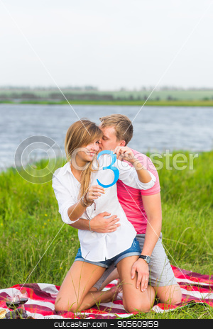 Man and woman holding the number 3 in nature. Concept of numbers, measurement, amount, quantity, accounting and mathematics stock photo, Man and woman holding the number 3 in nature. Concept of numbers, measurement, amount, quantity, accounting and mathematics by Satura86