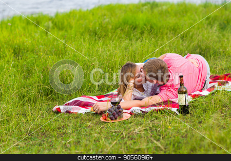 Beautiful love couple having romantic picnic outdoors on summer sunny day stock photo, Beautiful love couple having romantic picnic outdoors on summer sunny day by Satura86