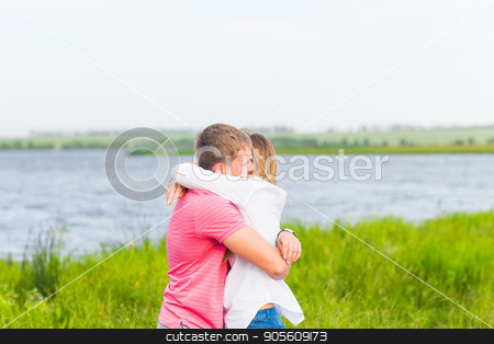 Happy Couple Together Relaxing on Green Grass. Park. Young Couple In Love Outdoor stock photo, Happy Couple Together Relaxing on Green Grass. Park. Young Couple In Love Outdoor by Satura86