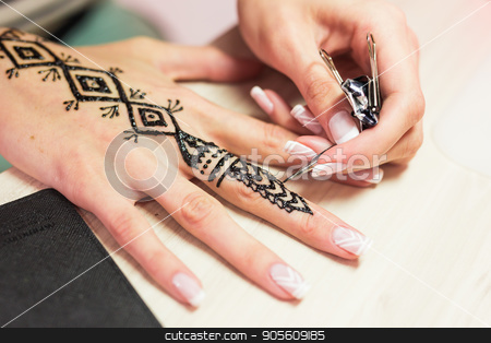 Drawing process of henna menhdi ornament on woman's hand stock photo, Drawing process of henna menhdi ornament on woman's hand by Satura86