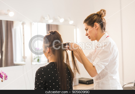 Hairdresser doing haircut for women in hairdressing salon. Concept of fashion and beauty. Positive emotion stock photo, Hairdresser doing haircut for women in hairdressing salon. Concept of fashion and beauty. Positive emotion by Satura86