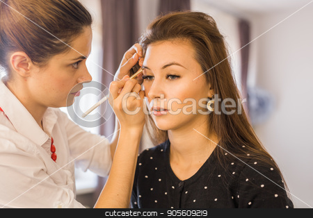 Woman making beauty and make up treatment in a saloon. Concept about beauty and people stock photo, Woman making beauty and make up treatment in a saloon. Concept about beauty and people by Satura86