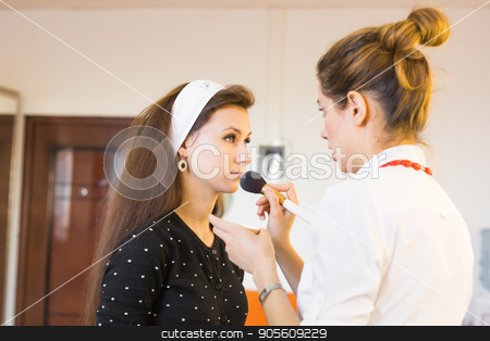 beauty and makeup concept - closeup portrait of beautiful woman getting professional make-up with brush stock photo, beauty and makeup concept - closeup portrait of beautiful woman getting professional make-up with brush by Satura86