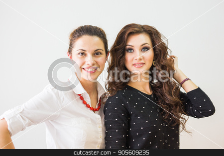 Make-up Artist and Beautiful Fashion Model stock photo, Make-up Artist and Beautiful Fashion Model in salon by Satura86