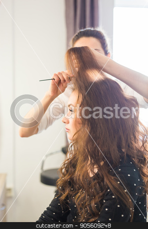 beauty and people concept - happy young woman with hairdresser at hair salon stock photo, beauty and people concept - happy young woman with hairdresser at hair salon by Satura86