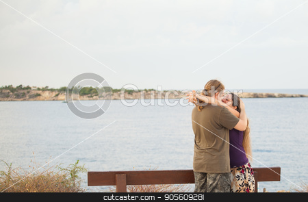 Attractive couple embracing on the beach on a sunny day stock photo, Attractive couple embracing on the beach on a sunny day by Satura86