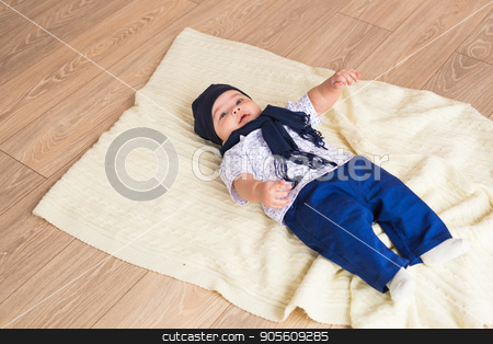 Portrait of a little adorable newborn infant baby boy lying on back on blanket stock photo, Portrait of a little adorable newborn infant baby boy lying on back on blanket by Satura86