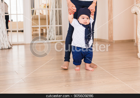 baby taking first steps with mother help stock photo, baby taking first steps with mother help by Satura86
