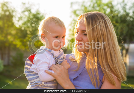 baby boy with his mum outdoors stock photo, baby boy with his mum in the park by Satura86