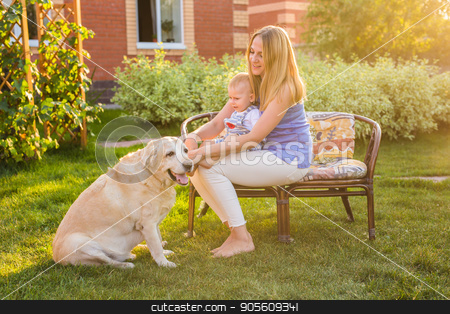 Happy family playing with their dog on a sunny day stock photo, Happy family playing with their dog on a sunny day by Satura86