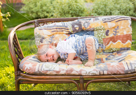 Cute unhappy baby boy with blond hair crying outdoors on sunny summer day stock photo, Cute unhappy baby boy with blond hair crying outdoors on sunny summer day by Satura86