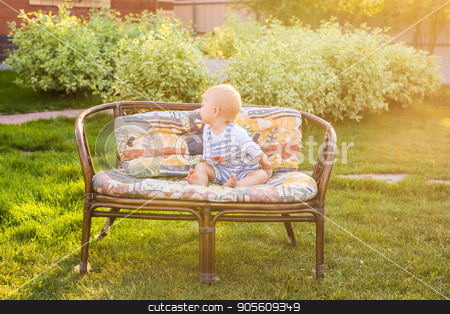 Cute caucasian baby boy in park stock photo, Cute caucasian baby boy in summer green park by Satura86