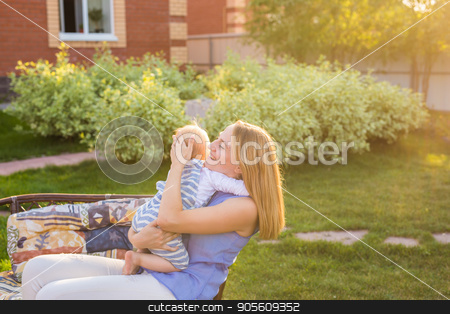 happy family mother and baby hugging and kiss in summer on the nature stock photo, happy family mother and baby hugging and kiss in summer on the nature by Satura86