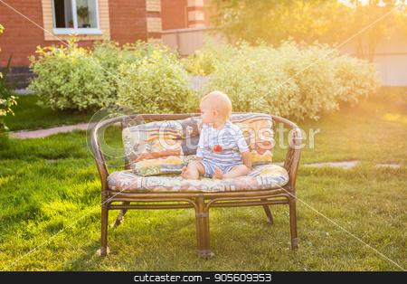 Cute caucasian baby boy in park stock photo, Cute caucasian baby boy in summer green park by Satura86