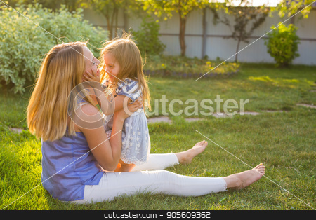 happy family mother and daughter hugging in summer on the nature stock photo, happy family mother and daughter hugging in summer on the nature by Satura86