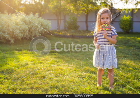 Funny child with candy lollipop, happy little girl eating big sugar lollipop, kid eat sweets stock photo, Funny child with candy lollipop, happy little girl eating big sugar lollipop, kid eat sweets by Satura86