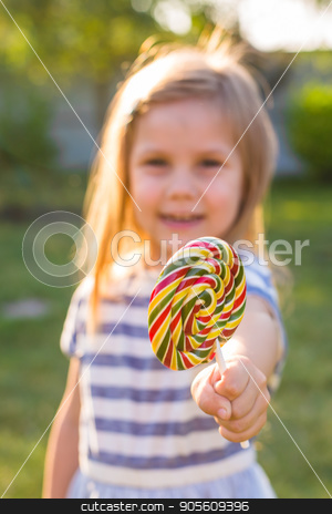 Funny child with candy lollipop, happy little girl eating big sugar candy stock photo, Funny child with candy lollipop, happy little girl eating big sugar lollipop, kid eat sweets. surprised child with candy. isolated on bright background, studio. Beautiful little girl with lollipop by Satura86
