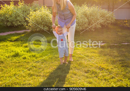 First steps with mother's help stock photo, First steps with mother's help in the garden by Satura86