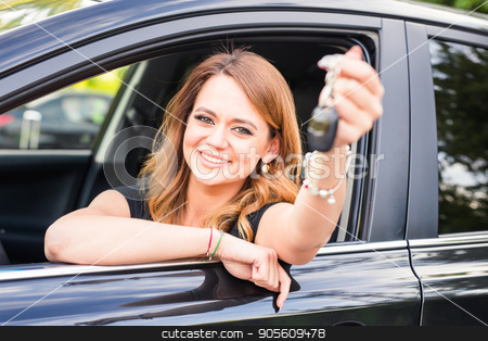 Young happy woman in the car with keys in hand - concept of buying car stock photo, Young happy woman near the car with keys in hand - concept of buying car by Satura86
